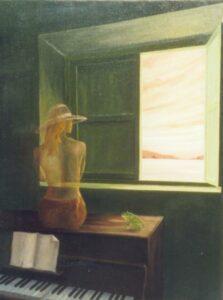 une femme devant un clavier regarde une fenêtre